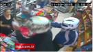 Kadın esnaf silahlı hırsızları bıçakla kovaladı