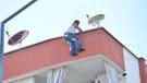 İntihar için çatıya çıktı, beni kameraya çekin diye seslendi