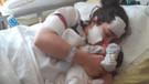 Doğum yaptığı hastanede bıçaklanan kadın, bebeğini kucağına aldı