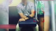Pes dedirtti! Metroda kadının etek altı görüntülerini çekti!