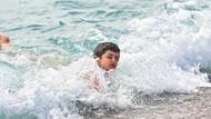 Çocuklar yüzdü, büyükler güneşlendi