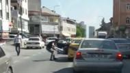 Taksici, genç kadını bacağından tutup arabadan attı