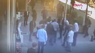 Sokak ortasında eşini döven adama kafa atan vatandaş gündem oldu