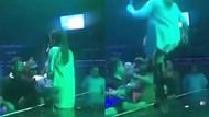Sahnedeki mini etekli şarkıcıyı taciz etti, bedeli ağır oldu
