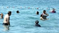 Van Gölü'nün mavi bayraklı Mollakasım Halk Plajı'na tatilci akını