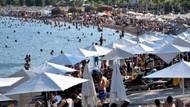 Marmaris plajları tıklım tıklım! Tatilciler mavi bayraklı plajlara akın etti