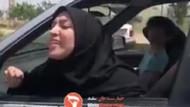 İran'da bir kadın başörtüsü takmayan hemcinsini darp etti