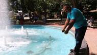 Kadının süs havuzuna batırdığı bebeği kurtardı
