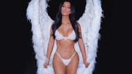 Kim Kardashian Kourtney Kardashian için poz verdi