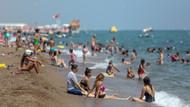 Antalya'da nemden bunalan sahile koştu