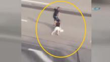 Kadını saçlarından tutup cadde boyunca sürükledi