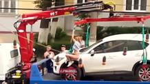 Aracının çekilmesini engellemek için soyunan kadın!
