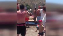 Bodrum'da plajda şortunu çıkardı, dayak yedi!