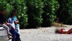 Tacizciler Bodrum'da sahilde güneşlenen kadını rahat bırakmadı