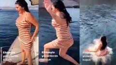 Ebru Polat elbisesiyle denize girdi