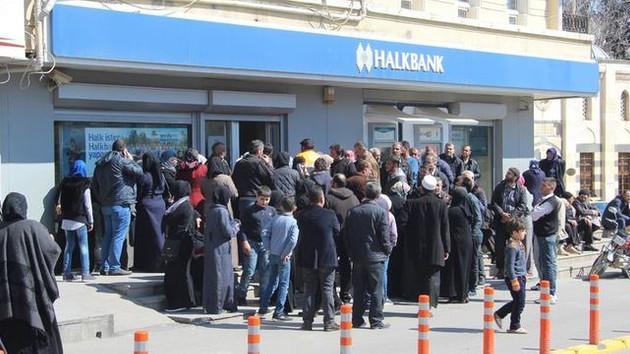 Suriyelilere 100 TL'lik bankamatik kartı dağıtılıyor