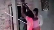 Hindistan'da adam karısını sevgilisiyle basınca, sütunlara bağlayıp...