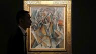 Picasso'nun Femme Assise tablosu 64 milyon dolara satıldı