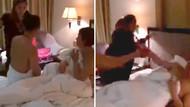 Evli kadın, kocasını metresiyle otel odasında bastı