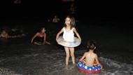 Antalya'da nemden bunalan tatilciler sahilde sabahladı
