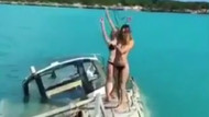 Batan teknede bikinileriyle yardım istediler!