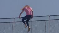 Kahraman polis köprüden atlayan kadını havada yakaladı