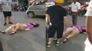 Aldattı dedi karısını sokak ortasında defalarca tekmeledi