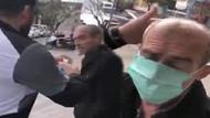 Yaşlı adamı zorla durdurdular, maske takıp başına kolonya döktüler!
