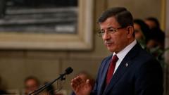 Davutoğlu'ndan Erdoğan'ın bağış kampanyasına tepki
