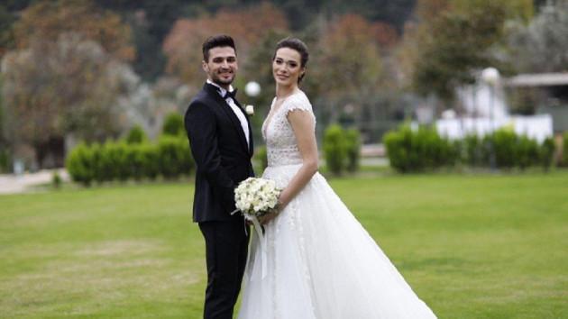 Milli futbolcu Okay Yokuşlu Melisa Kerman ile evlendi